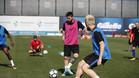 Leo Messi e Ivan Rakitic durante el entrenamiento del Barça de este viernes