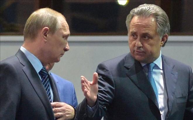 Vladimir Putin junto al ministro de Deportes Vitaly Mutko