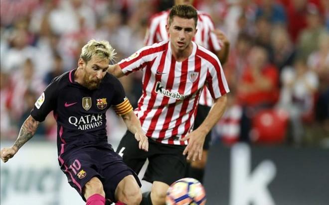 Laporte, con Messi, en el Athletic-FC Barcelona del pasado 28 de agosto