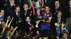 Spain\'s Prince Felipe (C-L) gives the King\'s Cup to Barcelona\'s midfielder Xavi Hernandez (C-R) at the end of the Spanish King\'s Cup final football match between Athletic Bilbao and FC Barcelona at the Vicente Calderon stadium in Madrid on May 25, 2012. Barcelona defeated Athletic Bilbao 3-0. AFP PHOTO/JAVIER SORIANO