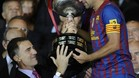 Barcelona\'s midfielder Xavi Hernandez (R) receives the Spanish King\'s cup from Spain\'s prince Felipe (L), after winning the Spanish King\'s Cup final football match against Athletic Bilbao at the Vicente Calderon stadium, in Madrid, on May 25, 2012. Barcelona defeated Athletic Bilbao 3-0. AFP PHOTO/ RAFA RIVAS