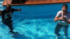Abidal, con Piqu en la piscina