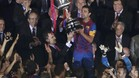 Barcelona's Xavi holds the Spanish King's Cup trophy after winning their final soccer match against Athletic Bilbao in Madrid
