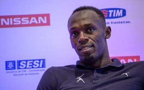 Bolt corre de guía a la atleta ciega más rápida del mundo