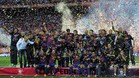Barcelona\'s players celebrates after winning the Spanish King\'s Cup final match between Athletic Bilbao and FC Barcelona at the Vicente Calderon stadium in Madrid on May 25, 2012 AFP PHOTO / JOSEP LAGO