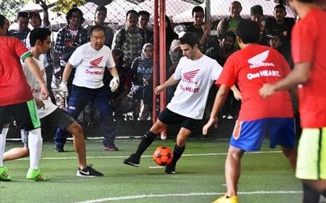 Pedrosa y Nakamoto, durante el partido