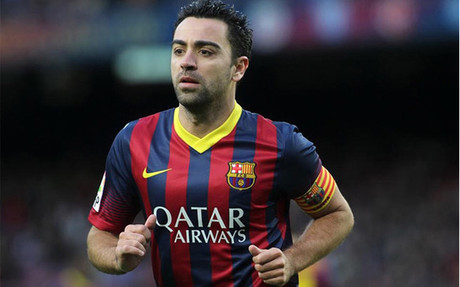 Xavi playing for Barca last season