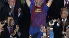 Barcelona's Xavi lifts up the Spanish King's Cup trophy after winning their final soccer match against Athletic Bilbao in Madrid