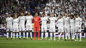 Minuto de silencio antes del encuentro entre Madrid y Tottenham