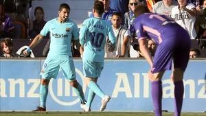 Suárez celebrando el gol frente al Leganés junto a Messi