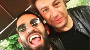 Ahmet Bulut, junto a Arda Turan