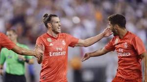Bale y Asensio celebran uno de los goles