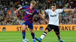 La plantilla del Valencia vivió una noche aciaga en el Camp Nou