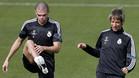 Pepe Lima y Fabio Coentrao durante un entrenamiento del Real Madrid en la Ciudad Deportiva en Valdebebas