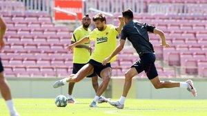 Piqué, en el entrenamiento del Barça