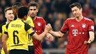 Lewandowski y Delaney se saludan tras el último Bayern-Borussia