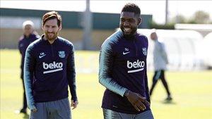 Umtiti y Messi, en el entrenamiento del Barça