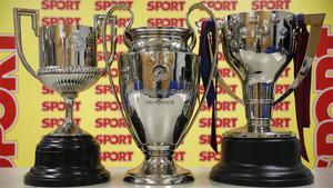 Los trofeos de la Copa del Rey, de la Champions y de la Liga española