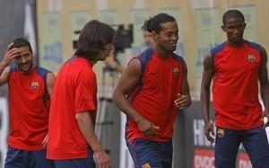 Messi, entre Giuly, Ronaldinho y Etoo