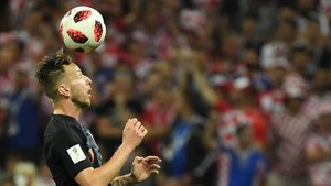 undefinedcroatia s midfielder ivan rakitic heads the ball d180711225806