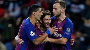 Suárez, Rakitic y Messi celebran uno de los tantos del Barça