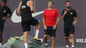 Arda, junto a Valverde en un entrenamiento