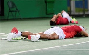 afabreguesspain s rafael nadal and spain s marc lopez react 160813031602