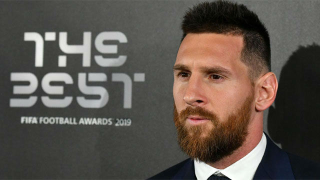 Messi wins Federation Internationale de Football Association player of the year as Ronaldo skips ceremony