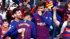 Leo Messi, con Piqué y Coutinho