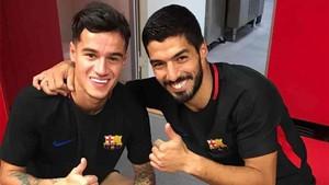 Coutinho, junto a Luis Suárez