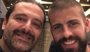 Saad Hairi y Piqué, durante la recepción