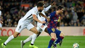 Germán y Messi, en el FC Barcelona - Granada, de LaLiga Santander