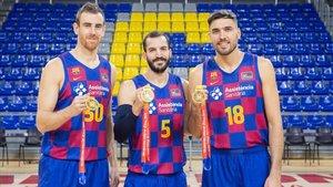 Claver, Ribas y Oriola, en el Palau con su medalla de oro