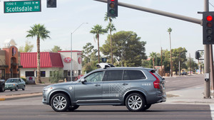 FILE PHOTO: A self driving Volvo vehicle, purchased by Uber, moves through an intersection in Scottsdale