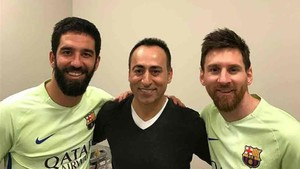 Lionel Messi and Arda Turan