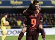 Messi y Suárez festejan un gol