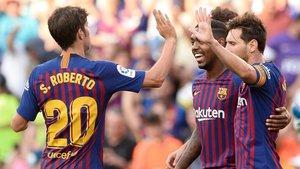 Sergi Roberto, Malcom y Messi celebran un gol del Barça en la temporada 2018/19