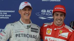 Michael Schumacher y Fernando Alonso en una imagen de archivo de 2012 en el circuito de Silverstone