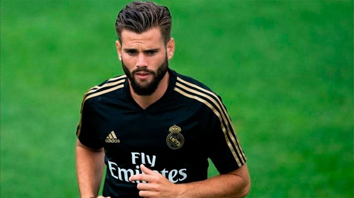 Nacho regresa al grupo en la primera parte de la sesión del Real Madrid