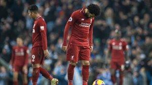 Los jugadores del Liverpool tras perder en Manchester
