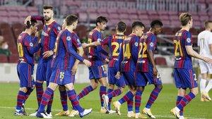 Los juagdores del Barça celebran un gol