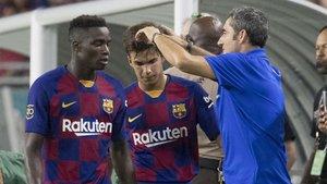 Moussa Wagué, Riqui Puig y Ernesto Valverde durante la pretemporada 2019/20 del Barça