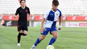 Aarón Rey durante un partido del play-off de ascenso