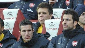 Szczesny, junto a Van Persie y Cesc, durante su etapa en el Arsenal