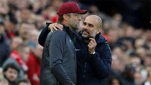 Klopp y Guardiola, en una imagen de esta temporada