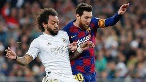 Una imagen del clásico. Messi y Marcelo, en acción