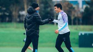 Eric Garcia junto a Pep Guardiola