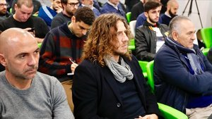 Carles Puyol junto a Iván de la Peña en su etapa como representante de jugadores