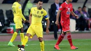 Xavi con la camiseta del Al Sadd