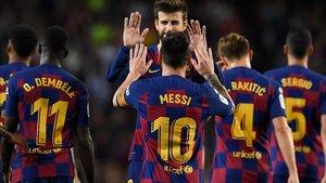 Los jugadores del Barça celebran un gol ante el Sevilla